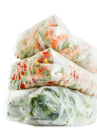 Frozen vegetables with ice closeup in studio