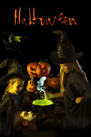 girl dress: Two little witch  cooks a magic potion on Halloween. Surrounded by pumpkins and spiders on a black background.