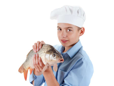 cypriniformes: Caucasian chef prepare a fish carp. Hilarious cooking wholesome food. Isolated on white background