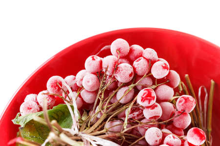 long lasting: Frozen viburnum on the red plate, for llong-term storage, ice and snow. Isolated on white background Stock Photo
