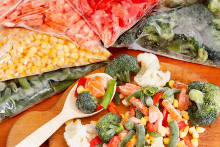 vegetable: Frozen vegetables on cutting board and plastic bags