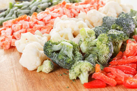 cut: Mixed frozen vegetables on cutting board can be used as background