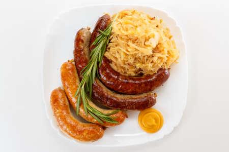 rosmarin: Octoberfest menu, plate of sausages and sauerkraut. Oktoberfest meal.