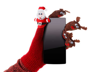 scratchpad: Christmas concept toy Santa Claus and reindeer with a gift in hand smartphone isolated on white background