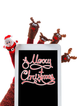 touchpad: Christmas concept toy Santa Claus and reindeer with a gift in hand touchpad. Text Merry Christmas. Isolated on White Background