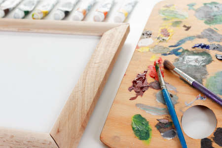 artist: Art palette with paint, border and a brush on white background