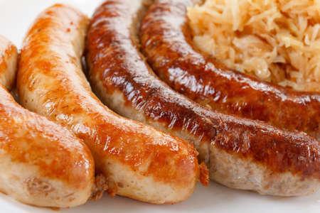 bier festival: Octoberfest menu, plate of sausages and sauerkraut. Oktoberfest meal.