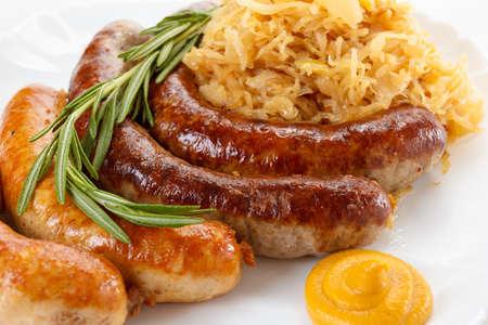 rosmarin: Traditional Octoberfest menu, plate of sausages and sauerkraut. Oktoberfest meal.