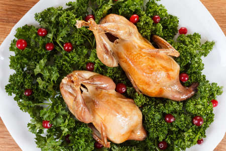 gamebird: Carcasses of quail roasted with sweet and sour cranberry sauce and parsley