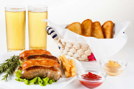 alehouse: October fest, traditional menu, roast beef or chicken sausage on a plate with ketchup, mustard and rosemary. White background