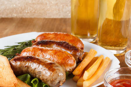 fest: October fest traditional menu, beer and roast beef or chicken sausage  with ketchup, mustard and rosemary. Wooden cutting board