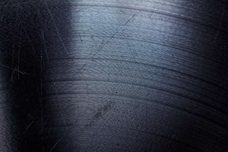 Segment of vinyl record showing the texture of the grooves, retro look Stock Photo