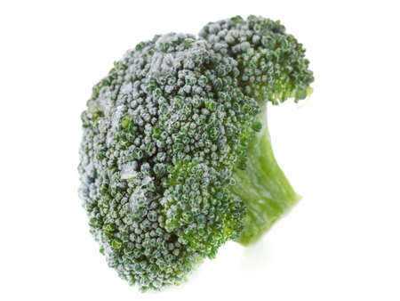 broccolli: Frozen broccoli with ice crystals isolated on white background with copy space.  Macro. Stock Photo