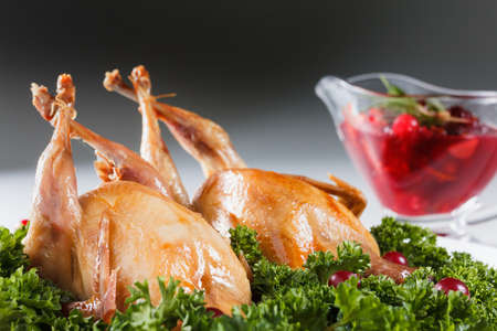 carcasses: Carcasses of quail roasted with sweet and sour cranberry sauce and parsley