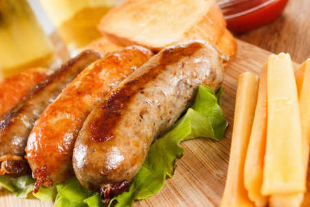 alehouse: October fest traditional menu, beer and roast beef or chicken sausage  with ketchup, mustard and rosemary. Wooden cutting board