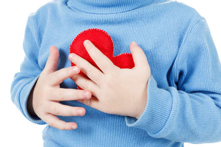Hands holding a heart symbol baby, clutching his chest. Concept of love, health and care Stockfoto