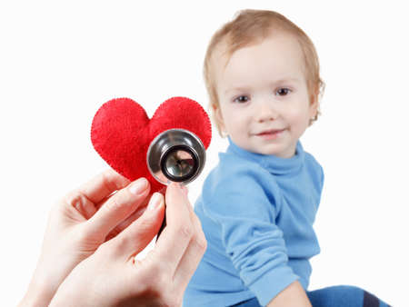 the cardiologist: Concept of health and care. Baby and cardiologist, heart symbol in hand and stethoscope.