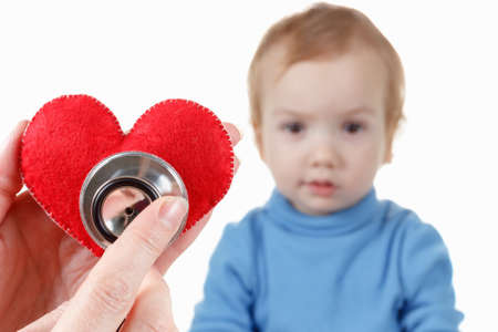 Concept of health and care. Baby and cardiologist, heart symbol in hand and stethoscope.