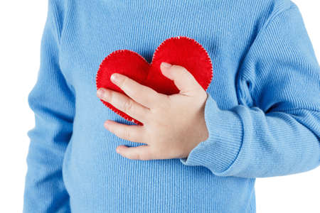 Hands holding a heart symbol baby, clutching his chest. Concept of love, health and care Standard-Bild