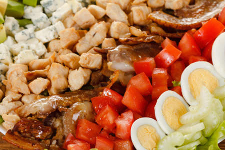 entree: Traditional American Cobb Salad - Colorful entree  salad with bacon, chicken, eggs and tomatoes. Closeup as background