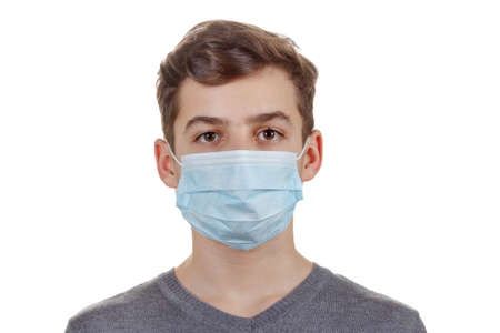 Cute sick boy in a mask. Isolated on white background