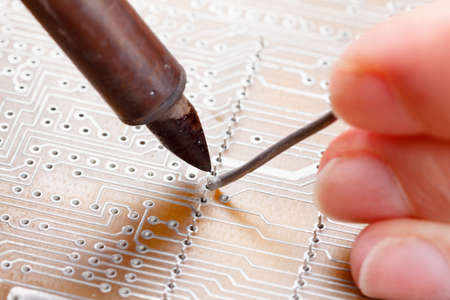 hardware repair: Electronic lab working place with soldering iron and circuit board