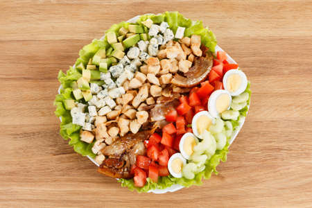 entree: Traditional American Cobb Salad - Colorful entree  salad with bacon, chicken, eggs and tomatoes a main-dish American salad Stock Photo
