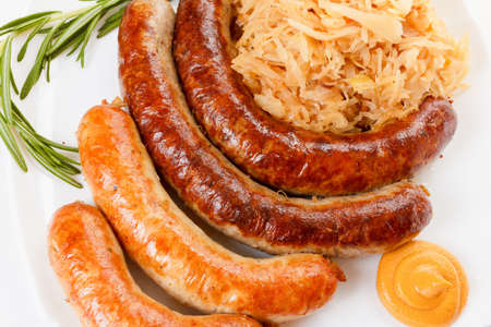Octoberfest menu, plate of sausages and sauerkraut. Oktoberfest meal.