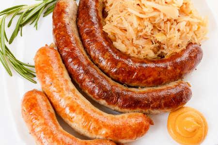 herbst: Octoberfest menu, plate of sausages and sauerkraut. Oktoberfest meal.