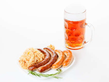 rosmarin: Octoberfest menu, beer mug with foam, a plate of sausages and sauerkraut. Oktoberfest meal.