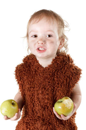 neanderthal: Little funny Neanderthal boy in a suit with a dirty face eating an apple. Humorous concept ancient caveman. Isolated on white.