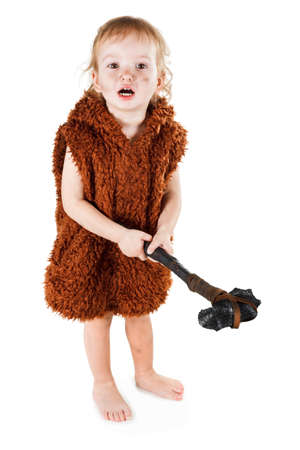 a cudgel: Little funny caveman boy in a suit with a dirty face holding an ax. Humorous concept ancient caveman. Isolated on white.