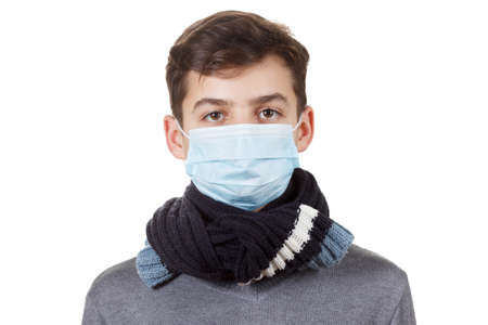 respire: Cute sick boy in a mask. Isolated on white background