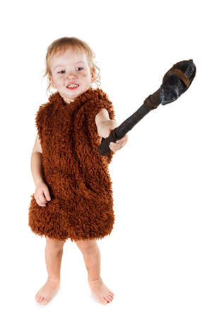 sapiens: Little funny caveman boy in a suit with a dirty face holding an ax. Humorous concept ancient caveman. Isolated on white.