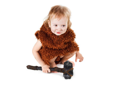 Little funny caveman boy in a suit with a dirty face holding an ax. Humorous concept ancient caveman. Isolated on white. Stock Photo - 55644287