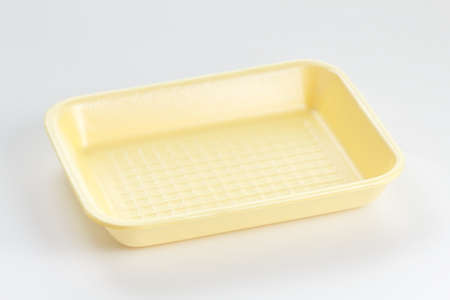 Yellow empty food tray on white background