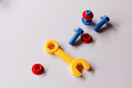 plastic toys: Plastic toys, screws and nuts on the table