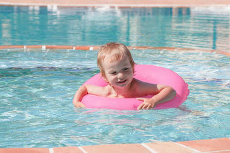 diving save: Little boy playing in the pool on a summers day holiday Stock Photo