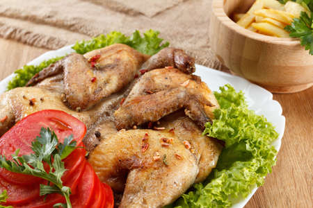 home cooked: Chicken fried with potato and vegetables, traditional home cooked rustic meal