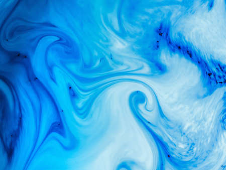 ink drop: Color drop in water, photographed in motion. Ink swirling in water. Cloud of ink in water on white. Colorful ink in water, ink drop.