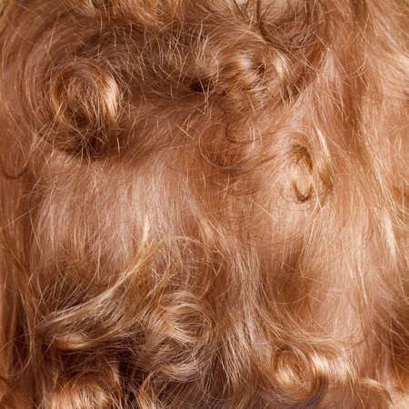 Background blond curly red hair boy closeup rear view, texture Stock Photo