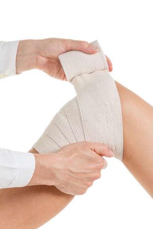 Flexible elastic supportive orthopedic bandage with white background, compression stabilizer knee. Stock Photo