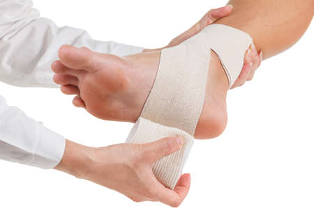 Flexible elastic supportive orthopedic bandage with white background, compression stabilizer ankle. Stock Photo