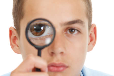 fish eye lens: Caucasian guy looking through a magnifying glass, with fish eye lens, isolated on white