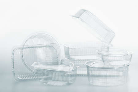 Group of transparent plastic containers box of food package on white background Standard-Bild