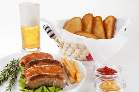 Oktoberfest beer traditional menu, roast beef or chicken sausage with ketchup, mustard and rosemary. White background