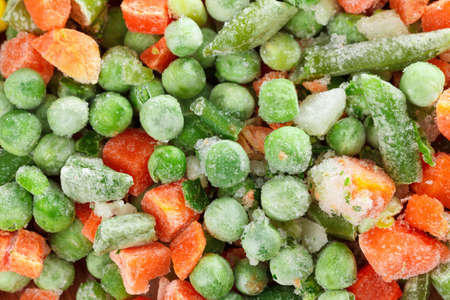 deep freeze: Frozen vegetables on cutting board for cooking. Closeup Stock Photo