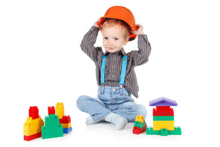 little boy in a red protective hardhat helmet isolated on white background Stock Photo - 65587250
