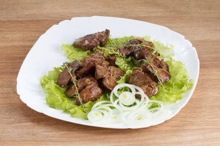 appetizing: Appetizing chicken liver cooked with onions, lettuce and spices Stock Photo