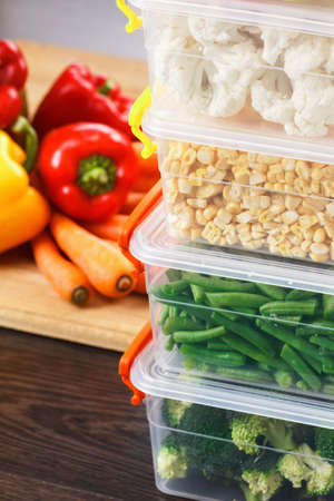 Trays with raw vegetables for freezing. Stocking up for winter storage in plastic containers Stock Photo - 65591524